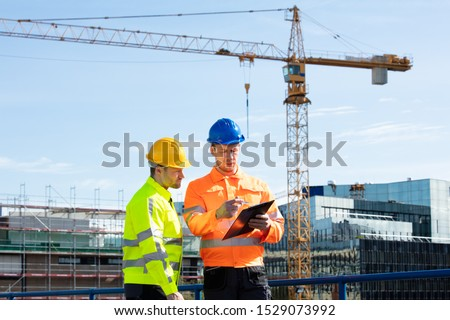 Two Male Engineers With Clipboard Working At Construction Site Stock photo © AndreyPopov
