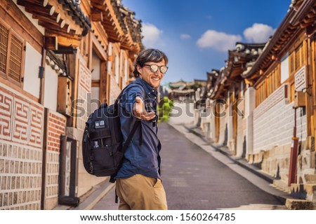 Young man tourist in Bukchon Hanok Village is one of the famous place for Korean traditional houses  Stock photo © galitskaya