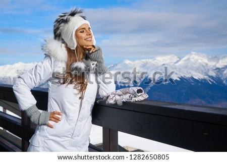 Woman snowboarder on a sunny winter day at a ski resort BANNER, LONG FORMAT Stock photo © galitskaya