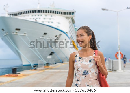 Cruise ship passenger leaving boat for shore excursion in harbour. Asian woman tourist spending a da Stock photo © Maridav