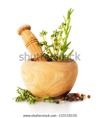 Grinding in a mortar medicinal herbs. Isolate on white backgroun Stock photo © g215