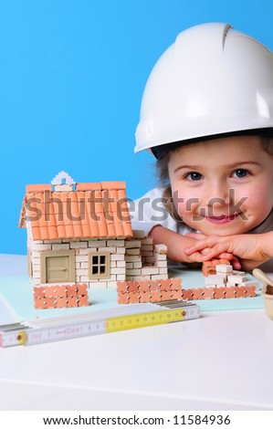 girl builder with drawings of a house  Stock photo © OleksandrO