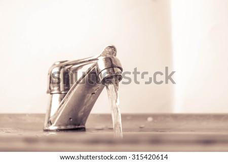 grifo · mezclador · agua · aislado · blanco · azul - foto stock © ozaiachin