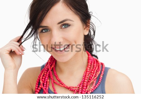Blue eyed woman posing with a red bead necklace against white background Stock photo © wavebreak_media