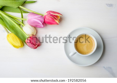 Coffee and tulips on a white wood table with some water on the t Stock photo © phila54