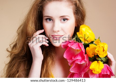 beautiful redhead girl with a bouquet of flowers stock photo © nejron