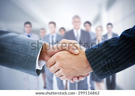 Composite image of smiling business people shaking hands while l Stock photo © wavebreak_media