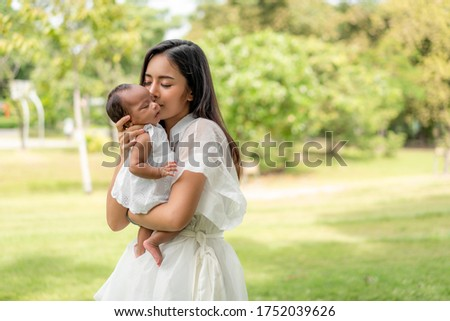 Adorable baby portrait. Happy beautiful mother holding her newbo Stock photo © Victoria_Andreas