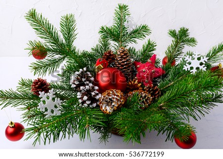 Christmas Table Centerpiece With Red Balls And Hand Decorated Pi Photo stock © TasiPas