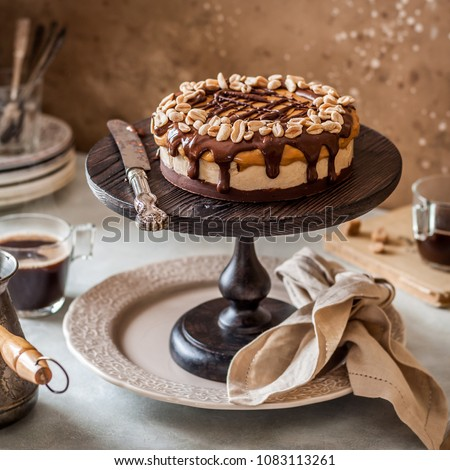 Caramel cream cake with nuts and chocolate layers. Homemade delicious dessert half sliced Stock photo © frimufilms