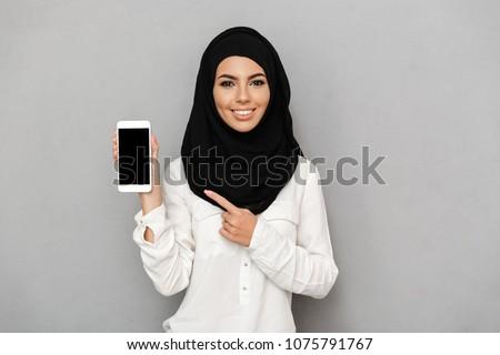 Portré muszlim nő fehér fátyol izolált Stock fotó © NikoDzhi