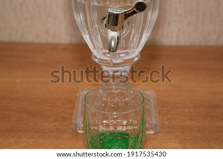 Transparent glass vase empty on a black wooden table, background. Stock photo © artjazz