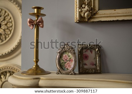 vintage picture in ornate golden frame and gold candle holder with burning candles isolated on white stock photo © lady-luck