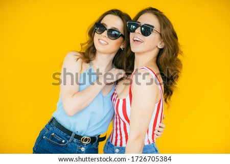 photo closeup of charming woman 20s wearing sunglasses and straw stock photo © deandrobot