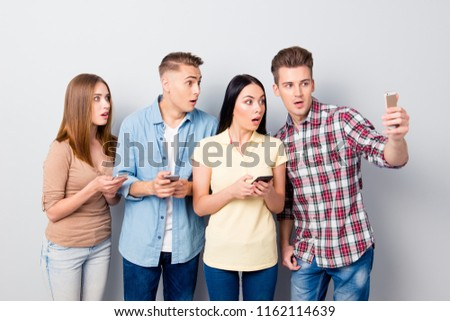 Shocked excited young group of friends standing isolated over white background. Stock photo © deandrobot