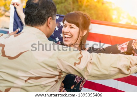 Excited Woman With American Flag Runs to Male Military Soldier R Stock photo © feverpitch