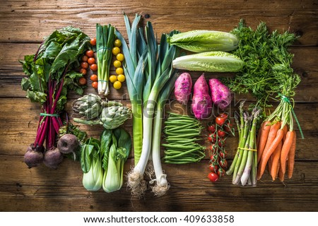 variety of green organic vegetables on rustic wooden background stock photo © marylooo