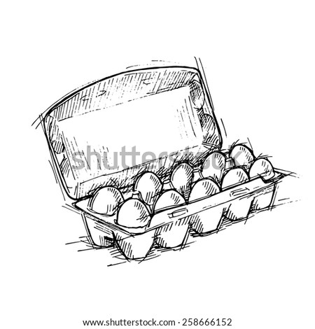 Stock photo: Farm chicken eggs in cardboard container and feathers on black b
