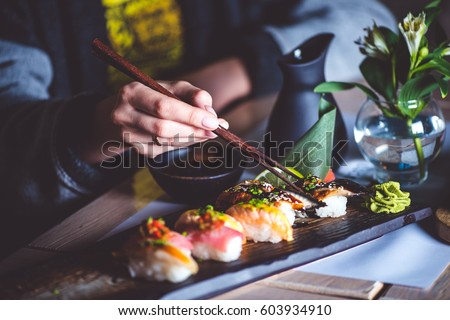 Woman eating japanese food in a japanese food restaurant VERTICAL FORMAT for Instagram mobile story  Stock photo © galitskaya