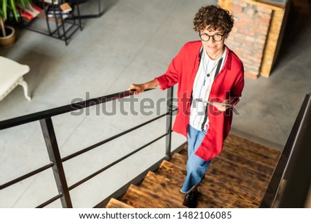 Young elegant desigher of fashion moving upstairs and looking at you Stock photo © pressmaster