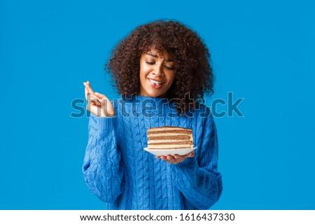 african american woman holding fingers crossed Stock photo © dolgachov