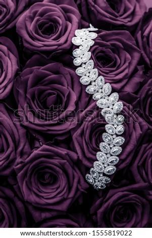 Luxury diamond jewelry bracelet and purple roses flowers, love g Stock photo © Anneleven