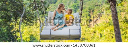 BANNER, LONG FORMAT Mother and son swinging in the jungle rainforest of Bali island, Indonesia. Swin Stock photo © galitskaya