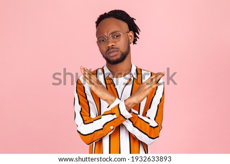 Warning sign with crossed out man on a background American flag. Stock photo © artjazz