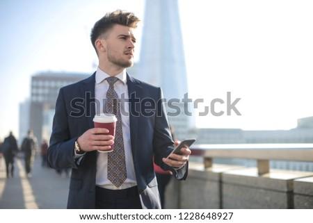 Atraente jovem barbudo empresário caminhada ao ar livre Foto stock © deandrobot