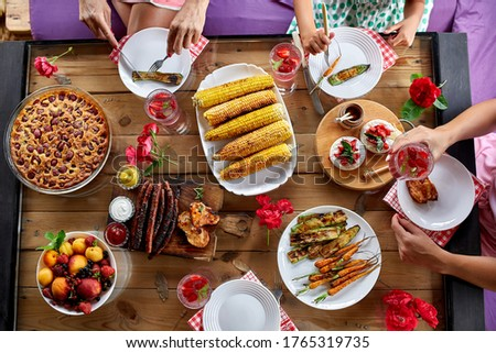 Top view over a dining table, decorated with flowers, family dinner. Stock photo © Illia