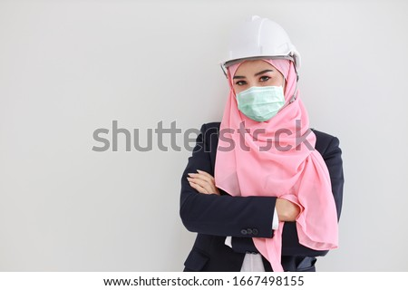 closeup portrait of young pretty engineer woman wearing helmet stock photo © hasloo