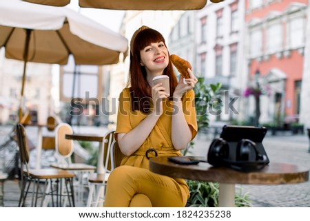 Attractive red-haired woman relaxing with her tablet while sitting on her bed Stock photo © wavebreak_media