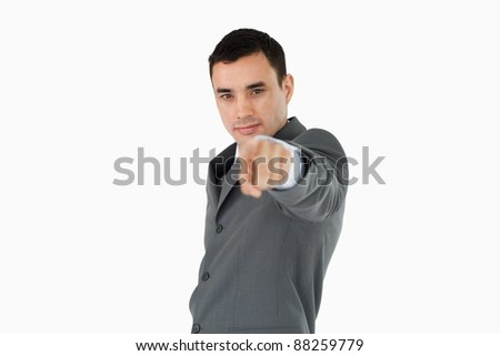 Side view of businessman pointing towards camera against a white background Stock photo © wavebreak_media