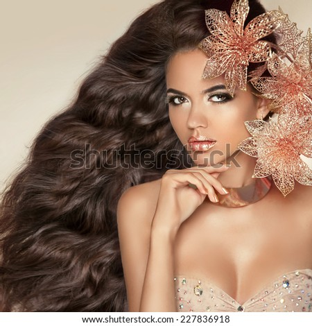 Beautiful brunette with long wavy hair. Professional makeup. Hai Stock photo © Victoria_Andreas