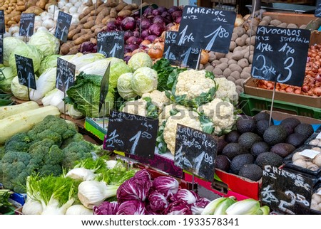 choice of cauliflowers and bunches of radish on market stock photo © nejron