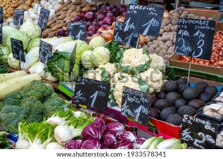 Choice of cauliflowers and bunches of radish on market Stock photo © Nejron