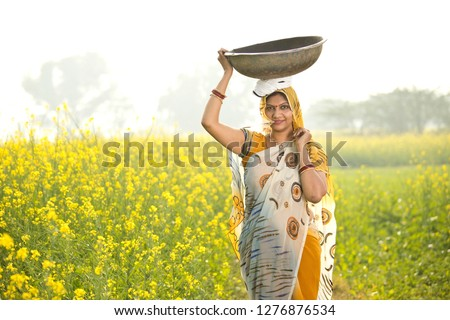 Female Farmer in Oilseed Rapeseed Cultivated Agricultural Field Stock photo © stevanovicigor