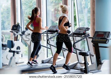man and woman workout on training simulator stock photo © deandrobot