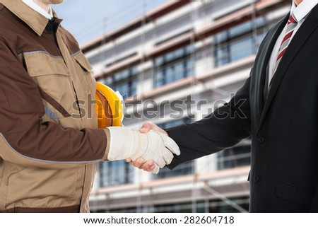 Hat weared on businessperson and holded by hands in gloves Stock photo © deandrobot