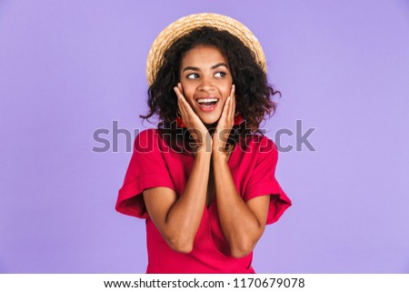 shy cute african american woman standing and touching her cheeks stock photo © deandrobot