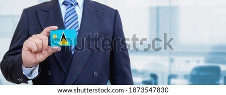 Credit card with Saint Lucia flag background for bank, presentations and business. Isolated on white Stock photo © tkacchuk