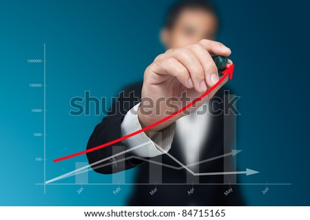 Сток-фото: Businesswoman looking at business graphic drawings