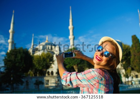 Girl making photo by the smartphone near the Blue Mosque, Istanb Stock photo © vlad_star