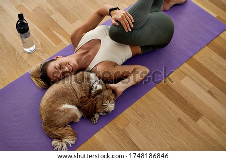 High angle view of woman exercising while lying on mat in yoga studio stock photo © wavebreak_media