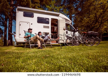 Woman resting near motorhomes in nature. Family vacation travel, Stock photo © cookelma
