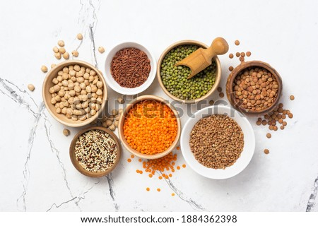 Cereals in wooden scoop set. Rice and lentils. Red beans and pea Stock photo © MaryValery