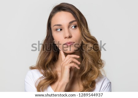 Young pretty woman with brooding look Isolated on gray background Stock photo © studiolucky