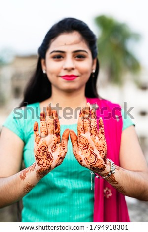 Portrait of a young woman in casual style with mehendi against the background of a big city Stock photo © galitskaya