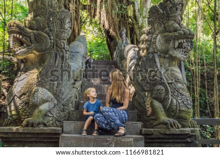 Mom and son travelers discovering Ubud forest in Monkey forest, Bali Indonesia. Traveling with child Stock photo © galitskaya