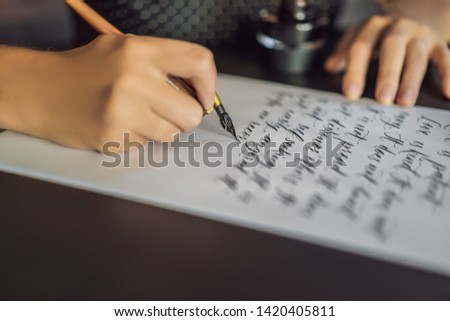 Calligrapher hands writes phrase on white paper. Phrase - Create more. Inscribing ornamental decorat Stock photo © galitskaya
